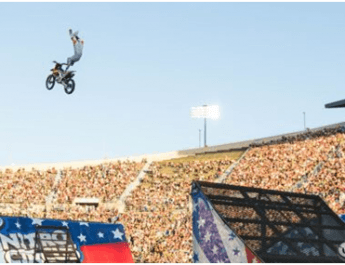 A Dirt Bike Flys Through The Air at the Nitro Circus
