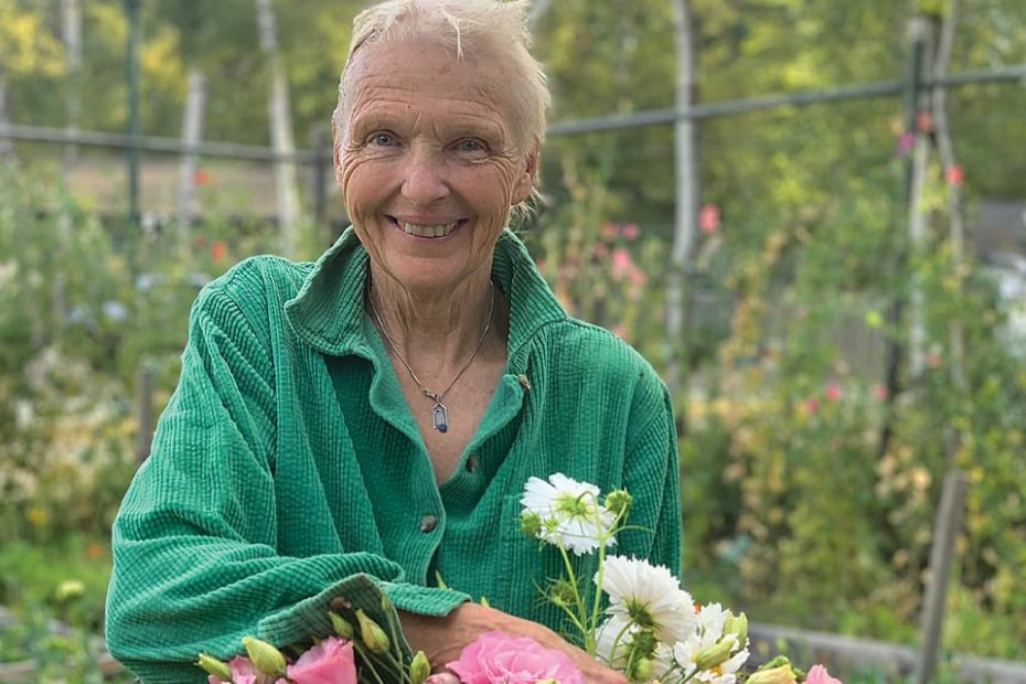 Barb Brant of Foolish Blooms holding flowers