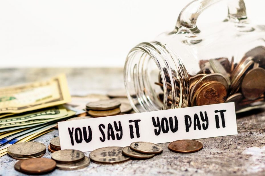 """Image of money next to a tipped over swearing jar. Sign says """"You say it you pay it"""""""