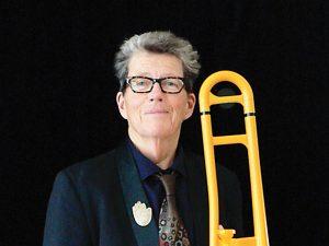 Jazz musician MJ Williams posing with trombone