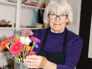 Photo of Judy Ericksen holding flowers