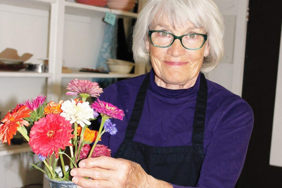 Photo of Judy Ericksen holding flowers