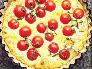 Close-cropped photo of garlic tomato quiche