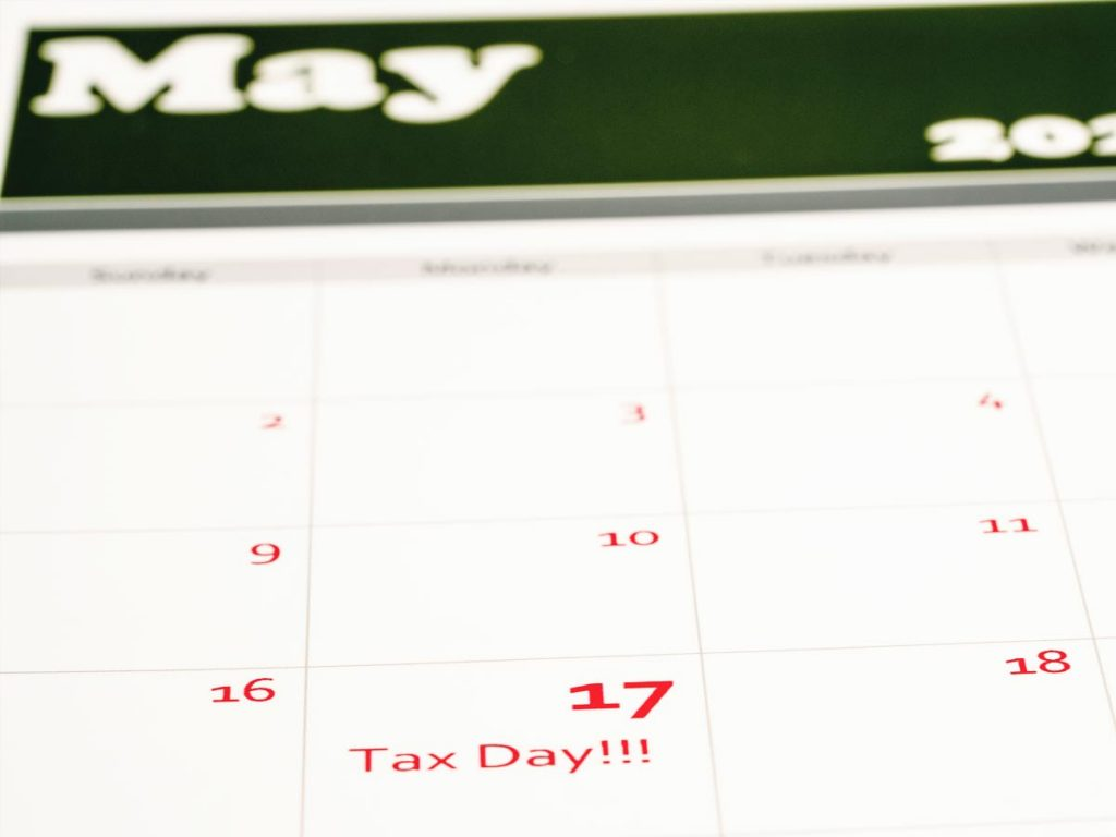 Photo of May calendar indicating extended tax filing deadline