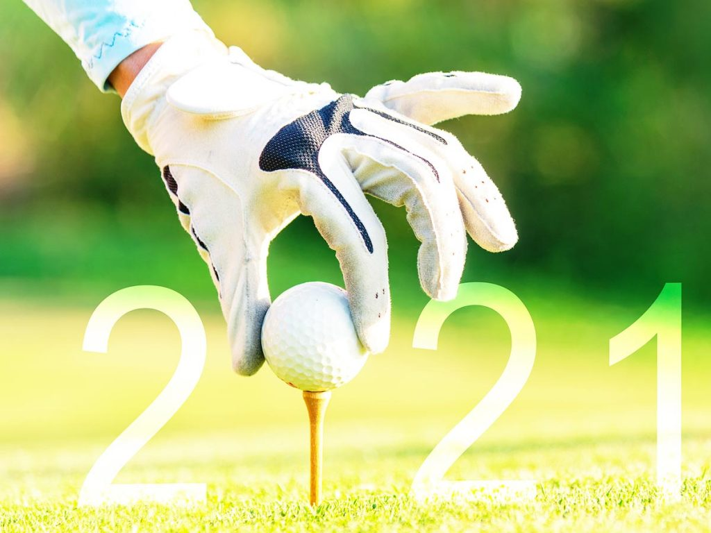 Photo of gloved hand putting golf ball on a tee, with the ball serving as the zero in an overlain 2021