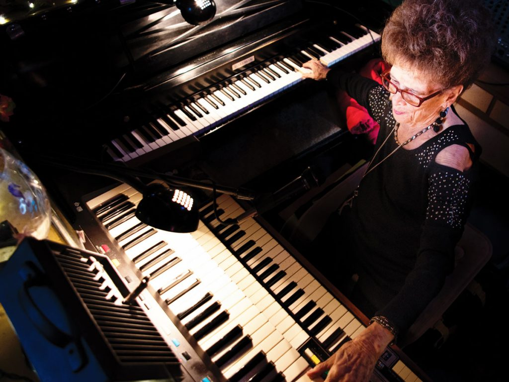 Overhead photo of Piano Pat playing two keyboards at the Sip n Dip in Great Falls, Mont.