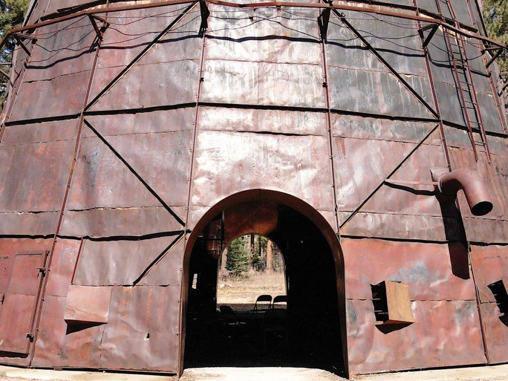 Photo of the exterior of the Tipi Burner at the Sculpture In the Wild exhibit in Lincoln, Mont.