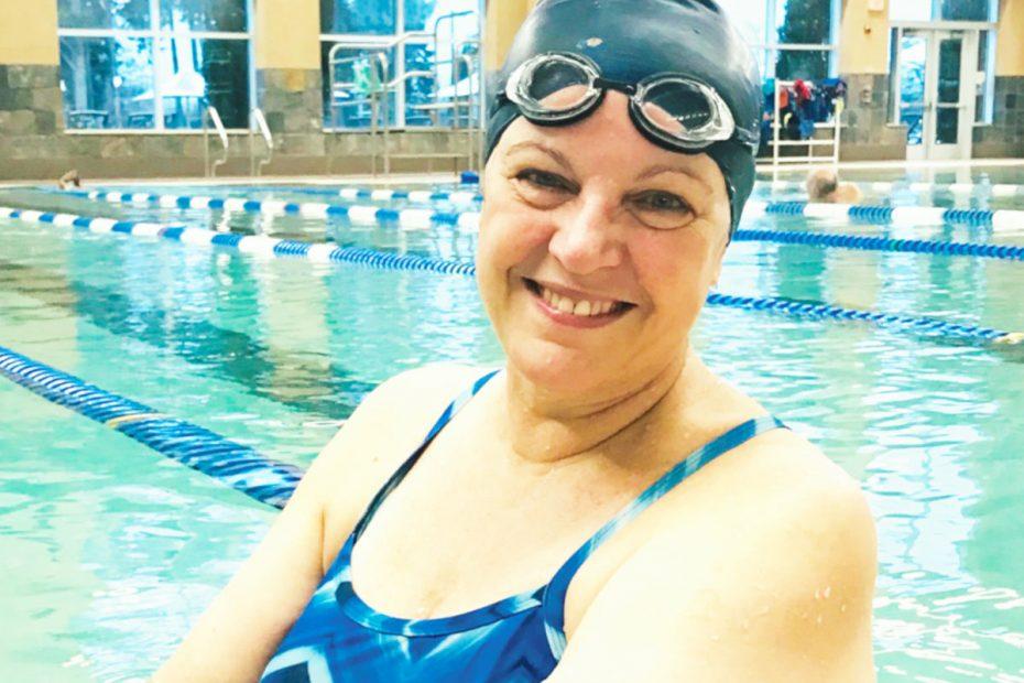 Photo of woman in a swimming pool, wearing a swim cap