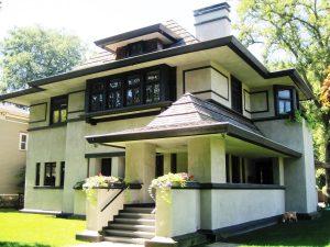Photo of a white stucco Craftsman house