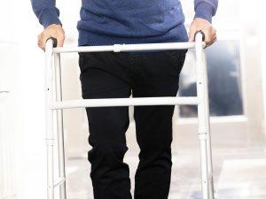 photo of senior using a walker, presumable after a biking injury