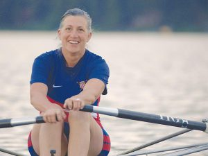 Former Olympian Monica Tranel Rowing on a Lake