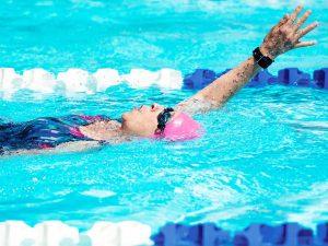 Senior woman swimming the backstroke in the Montana Senior Olympics