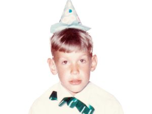 Photo of Bob Hunt, publisher of Montana Senior News, as a child, wearing a party hat.