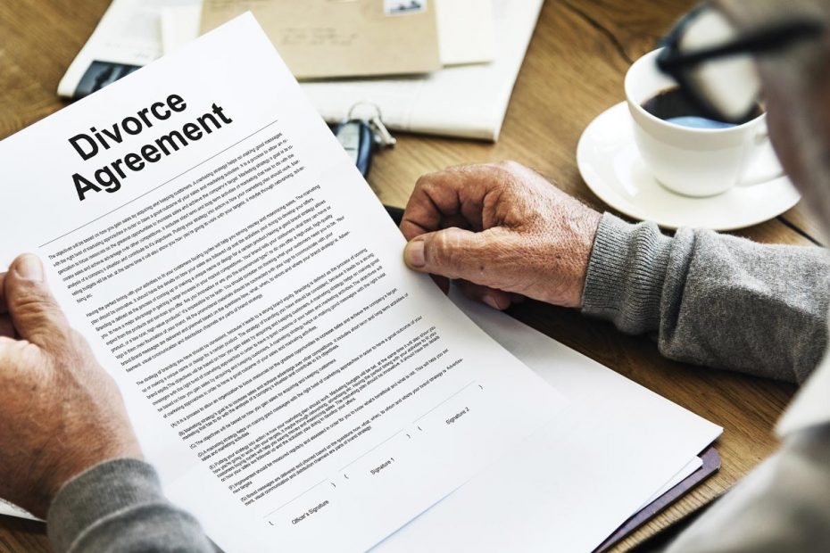 Image of senior man reviewing a divorce agreement.