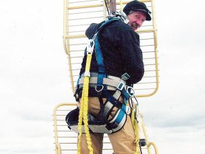 Photo of a man working on a TV relay tower near Bridger, Mont.